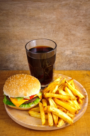 Fast food menu with burger, fries and cola