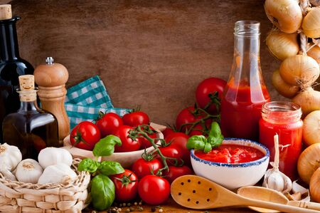 rustical: Still life with traditional homemade tomato sauce and ingredients