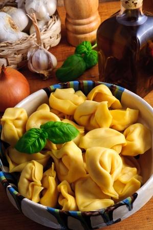 Still life with traditional italian tortellini pasta photo