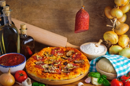 Traditional homemade salami pizza with ingredients photo
