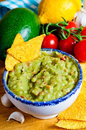 nacho: Fresh guacamole dip with avocado, ingredients and nacho chips