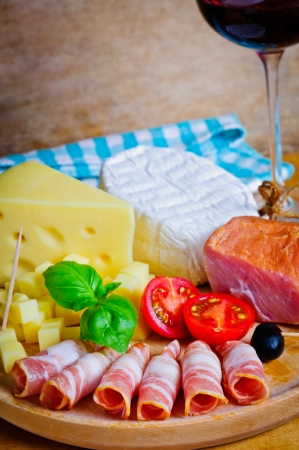 Cold plate with prosciutto and cheese photo