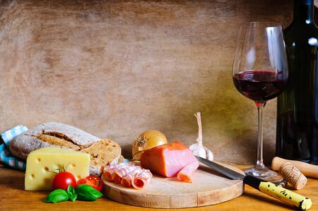 traditional rustic cold plate dinner and wine photo