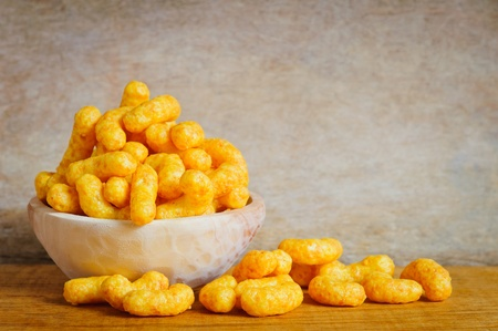 junk: Bowl with cheese curls snack Stock Photo