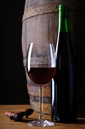 goblet: Still life with wooden barrel, glass and bottle of red wine