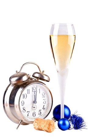 Happy new year celebration with glass of champagne wine and old alarm clock photo