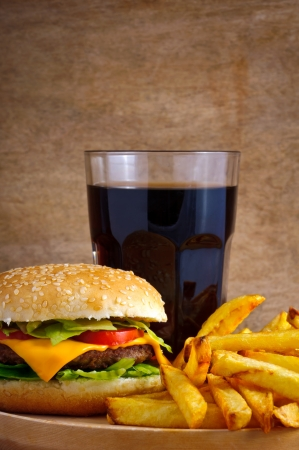 Junk food menu with hamburger, french fries and glass of cola