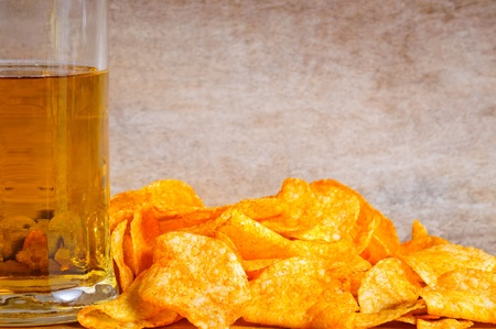 Background with beer, potato chips and text copy space photo