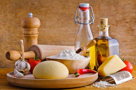 Traditional ingredients for homemade italian pizza photo