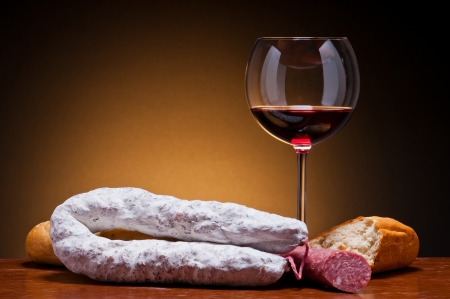 still life with traditional salami sausages and wine photo
