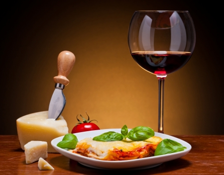 lasagna: still life with traditional lasagna, red wine and cheese