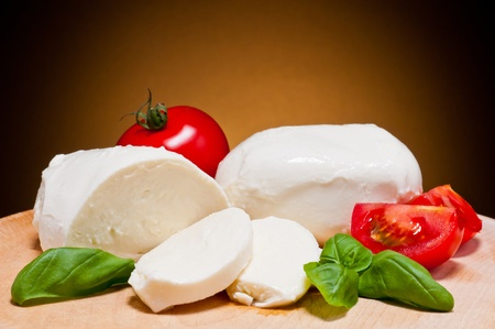 cheese plate: fresh mozzarella, tomatoes and basil Stock Photo