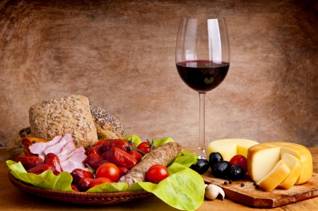 wine and food: still life composition with traditional food and wine Stock Photo