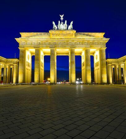 brandenburg gate in berlin, germany, at night photo