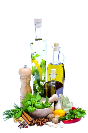 food dressing: infused olive oil with herbs and spices isolated on a white background