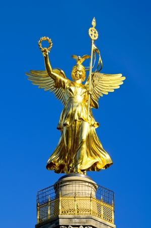angel figurine: golden angel statue on victory column berlin, germany Stock Photo