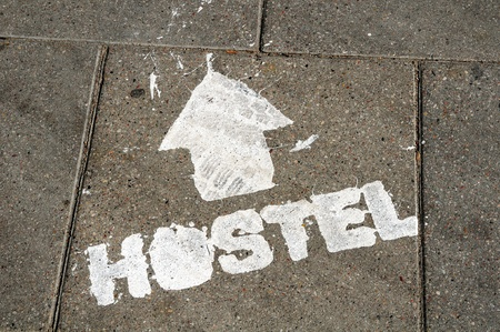 hostel sign on the ground photo