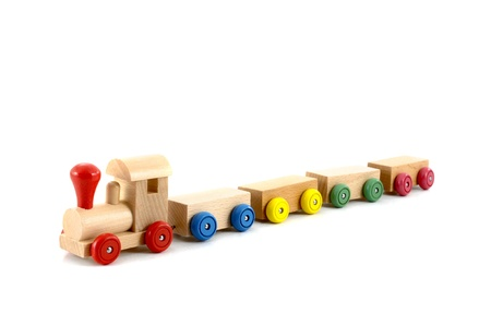 wooden toy train isolated on white background photo