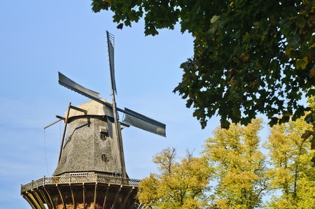 old windmill in the park from sanssouci palace in Potsdam, Germany photo