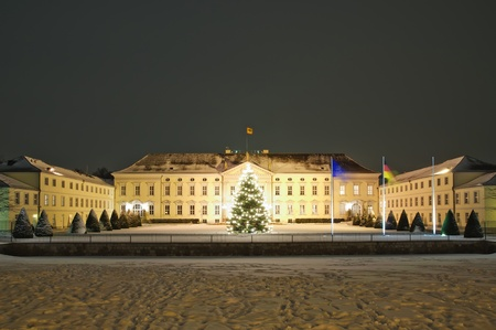 schloss bellevue in berlin in winter at night with beautiful christmas tree photo