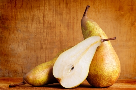 still life with pears on a wooden background photo