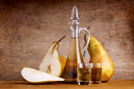 still life composition with fruit brandy and pears on a wooden vintage background