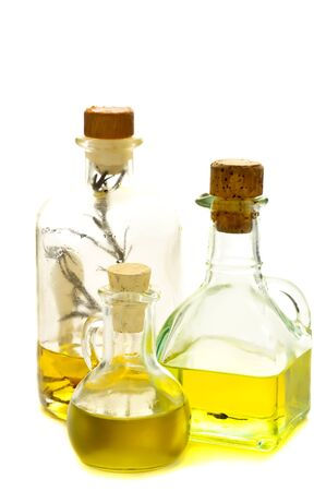 bottles of herbal and olive oil isolated on a white background photo