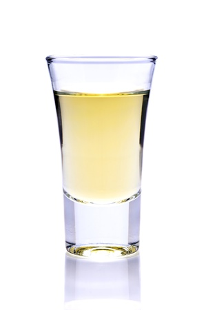 shot of tequila or whiskey isolated on a white background photo
