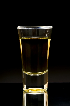 whiskey or tequila shot on a dark background