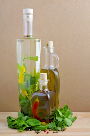 olive and herbal oil with fresh green herbs photo