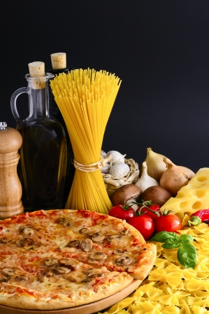 traditional italian food with pizza, pasta and ingredients