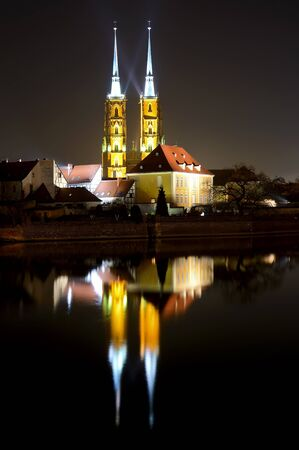 saint john the baptist cathedral in wroclaw, poland, at night photo