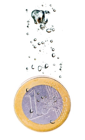 eurozone: Concept with euro coin sinking in water over a white background