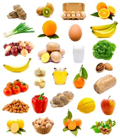 group of healthy food with fruits, vegetables, milk, bread and eggs isolated on a white background photo
