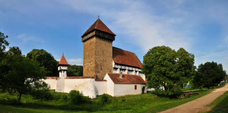 beautiful panorama of fortified church in stejarisu, transylvania, romania photo