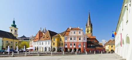 panorama with colorful houses on small square in sibiu, transylvania, romania