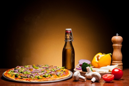 traditional homemade vegetarian pizza with fresh vegetables photo