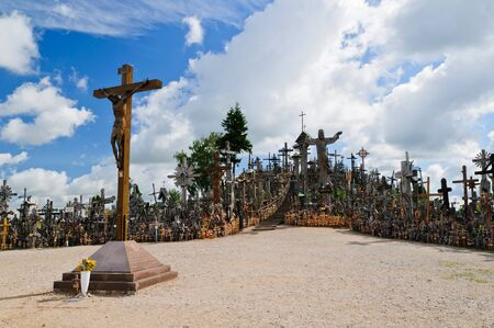 Crosses: view on hill of crosses in lithuania with blue cloudy sky