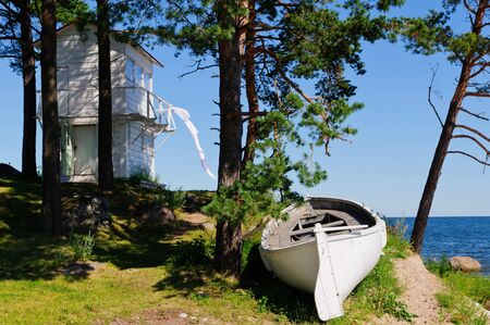 landscape with lighthouse and boat at beach in kaesmu, estonia Stock Photo