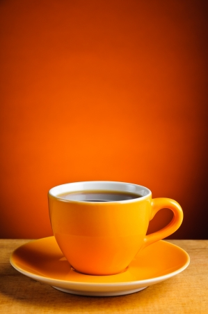 still life with orange espresso coffee cup