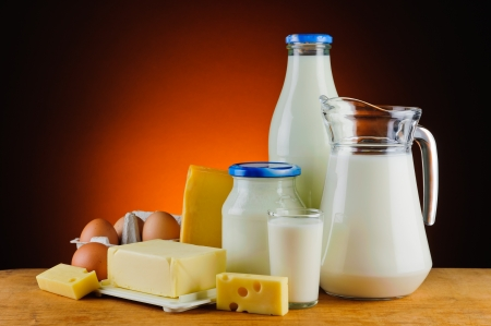 milk cheese: still life with organic dairy products, milk, cheese, butter and eggs