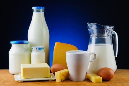 still life with organic dairy products, milk, cheese, butter and eggs photo