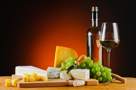 wine and food: still life with white wine, cheese and grapes