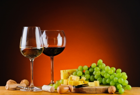 still life with cheese, wine and grapes photo