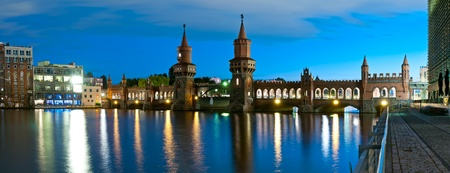 panorama with oberbaum bridge in berlin, germany, at night