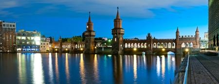 spree: panorama with oberbaum bridge in berlin, germany, at night