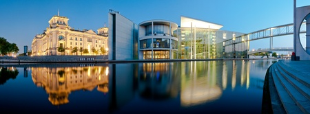 Berlin city panorama with reichstag and reichstagufer reflecting in spree river at night