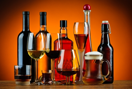 alcoholic: still life with various glasses and bottles of alcohol Stock Photo
