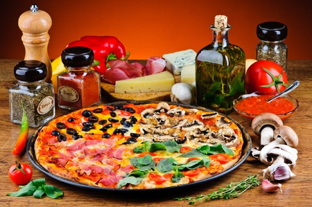 four season: still life with traditional quattro stagioni pizza and ingredients