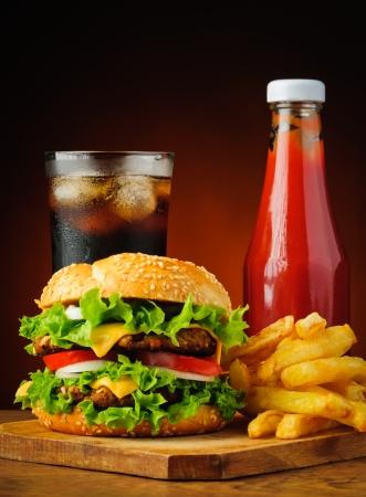burger and fries: hamburger, cola, french fries and ketchup
